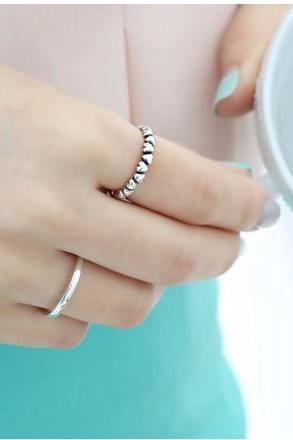 Love the heart connected joker tail ring